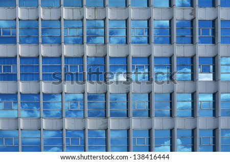 building with Multi windows Reflect Blue Sky - stock photo