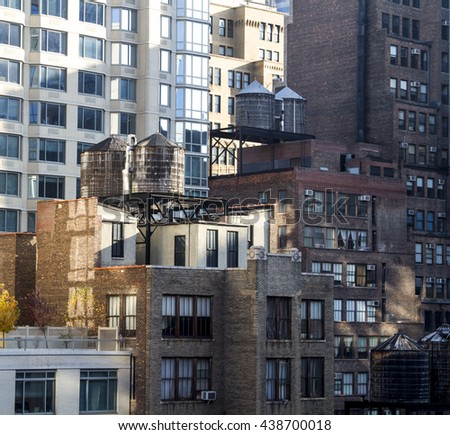 Building with water tower on their roof in New York City