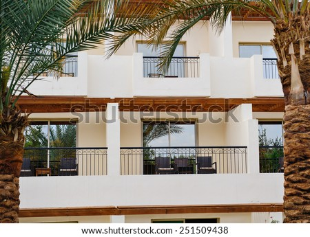 Building with window in a tropical setting. - stock photo
