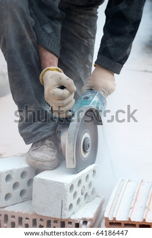 Building worker with disc grinder