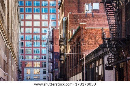 Buildings along an alley in Boston, Massachusetts. - stock photo