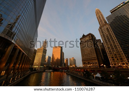 Buildings along Chicago River at sunset