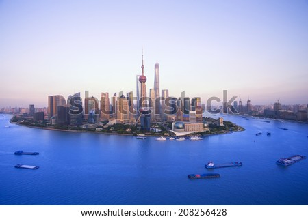 Buildings along the Huangpu river:west is shanghai bund and east is lujiazui finance center - stock photo