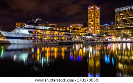 Buildings and boats reflecting in the Inner Harbor at night, Baltimore, Maryland. - stock photo