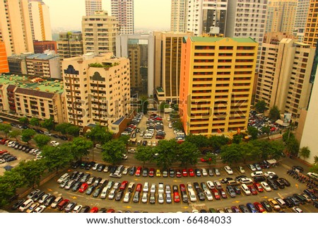 buildings and cars in the city of makati - stock photo