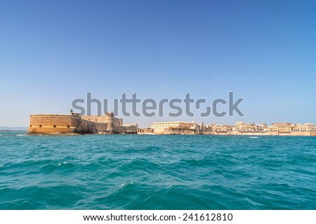 buildings and coastline view from waterfront in Syracuse, Sicily, Italy - stock photo