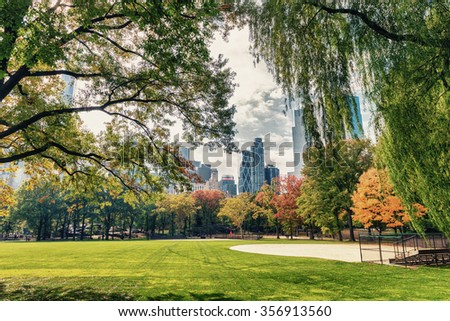 Buildings and foliage in Central Park, Manhattan. - stock photo