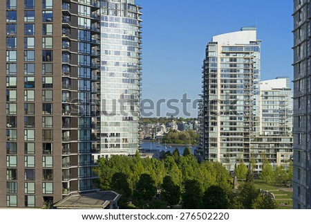 Buildings - apartment buildings in the park - stock photo