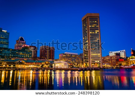 Buildings at the Inner Harbor at night, in Baltimore, Maryland. - stock photo