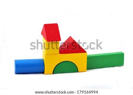 Buildings constructed out of toy wooden building blocks - stock photo