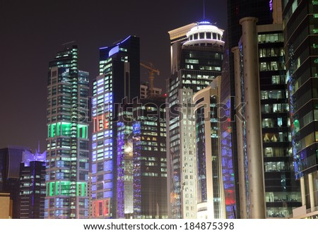 Buildings downtown in Doha at night. Qatar, Middle East - stock photo