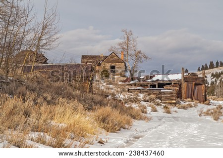 Buildings in an old mining town in Montana that is now a ghost town. - stock photo