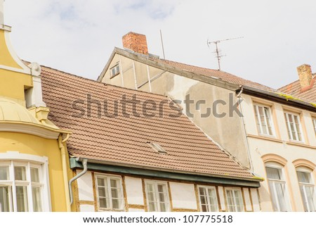 Buildings in historic Wismar, a Hanseatic League town in Northern Germany on the Baltic Sea, with elegant building styles from 14th-century Gothic to 19th-century Romanesque revival. - stock photo