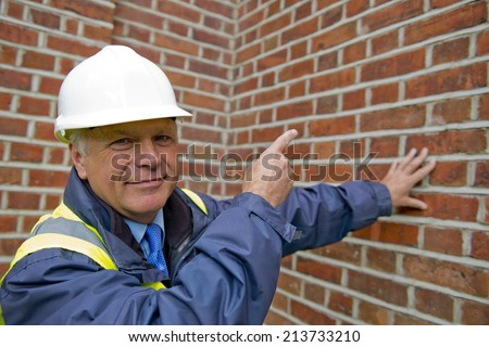 Buildings Inspector At Work - stock photo
