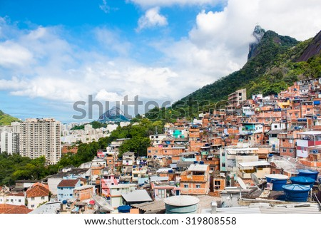 Buildings of Favela Santa Marta with Corcovado mountain behind in Rio de Janeiro, Brazil. - stock photo