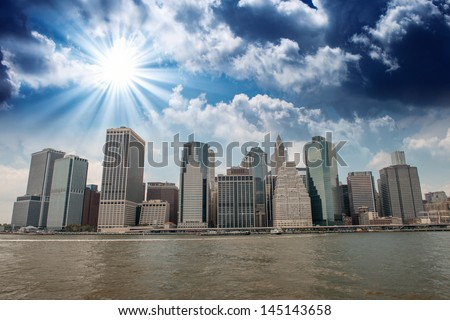 Buildings of Lower Manhattan as seen from East River - New York City. - stock photo