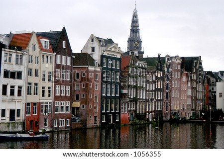 Buildings on Amsterdam Canal - stock photo