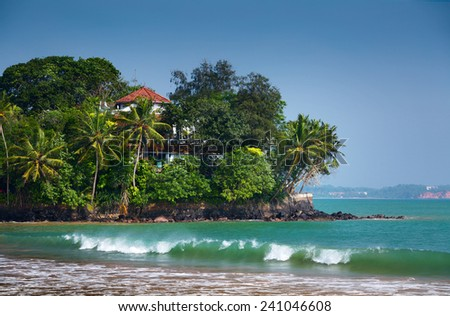 Buildings on the tiny island near the town of Weligama, Sri Lanka - stock photo