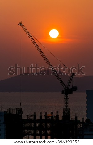 buildings under construction at sunset background