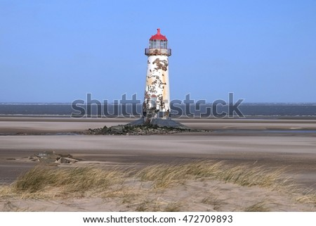 Built around 1776, The redundant lighthouse on the beach at Talacre, Flintshire, Wales. The foundations are now unstable, causing the lighthouse to tilt.