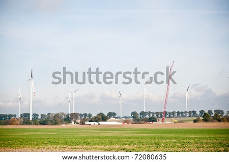 built wind turbine farm - stock photo