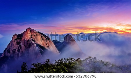 Bukhansan mountains is covered by morning fog and sunrise in Bukhansan National Park, Seoul in South Korea.