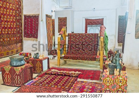 BUKHARA, UZBEKISTAN - APRIL 28, 2015: The interior of the Carpet museum with examples of traditional old carpets and the modern carpets for sell, on April 28 in Bukhara.