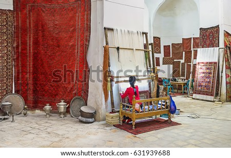 BUKHARA, UZBEKISTAN - APRIL 28, 2015: The workshop and carpet store located in the medieval trading dome, on April 28 in Bukhara.