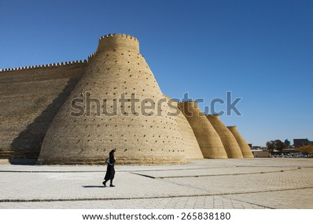 BUKHARA, UZBEKISTAN - MARCH 16, 2015:  Wall of the Bukhara Fortress, Uzbekistan - stock photo