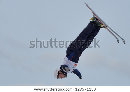 BUKOVEL, UKRAINE - FEBRUARY 23: Jonathon Lillis, USA performs aerial skiing during Freestyle Ski World Cup in Bukovel, Ukraine on February 23, 2013