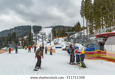 Bukovel, UKRAINE - February 24,The skiers are on a slope in Bukovel. It is the largest ski resort in Ukraine,on February 24, 2015 in Bukovel, Ukraine - stock photo