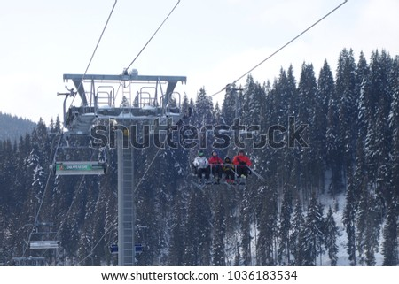 BUKOVEL, UKRAINE - FEBRUARY 25, 2018: Unidentified skiers climb on the lift in Bukovel, the largest ski resort in Eastern Europe