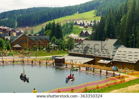 BUKOVEL, UKRAINE - JULY 11: unknown persons on holiday in the popular ski resort of Bukovel on July 11, 2015 in Bukovel - stock photo