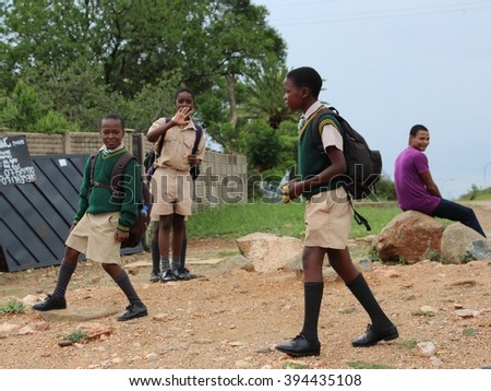 Bulawayo, Zimbabwe. 6th March 2016. Schoolboys play by the roadside in Bulawayo, Zimbabwe.
