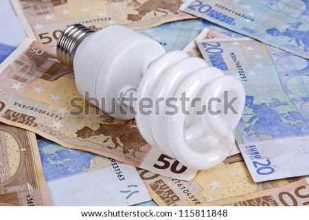 bulb and money, energy - stock photo