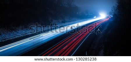 bulb exposure in the night on a german highway - stock photo