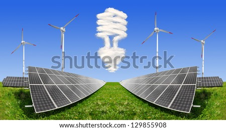 Bulb from clouds above the solar energy panels with wind turbines - stock photo