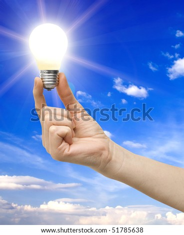 bulb in a hand on a background - stock photo