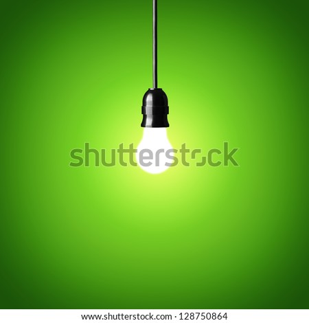 Bulb on green background.Idea concept. - stock photo