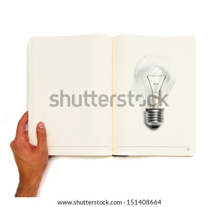Bulb printed on white book - stock photo