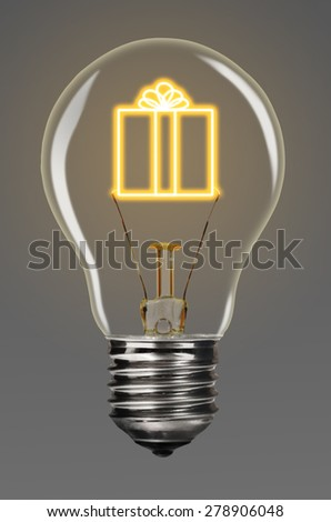 bulb with glowing gift inside of it, creativity concept - stock photo