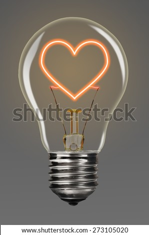 bulb with glowing red heart inside of it, creativity concept - stock photo