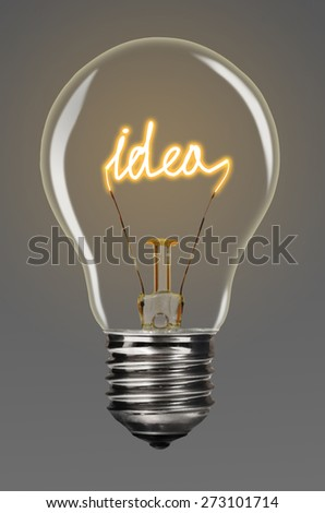 bulb with glowing word idea inside of it, creativity concept - stock photo