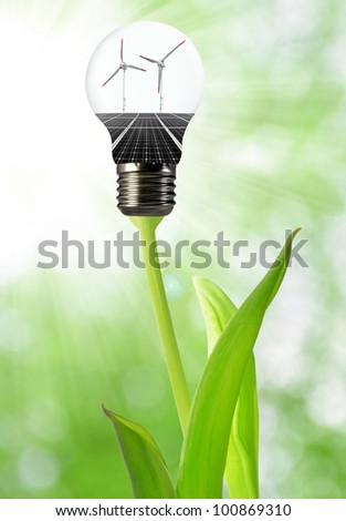 Bulb with of solar panel and wind turbines - stock photo