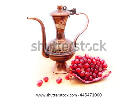 Bulbous ottoman ewer and a portion of ripe pomegranate. Concept of Middle East. Isolated on white - stock photo