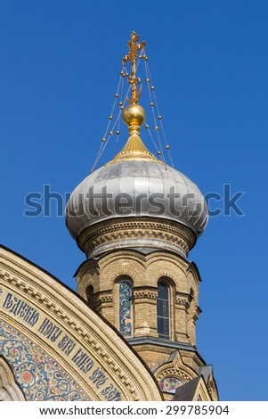 Bulbous spire of the catholic church of the Assumption of the Blessed Virgin Mary in St. Petersburg, Russia - stock photo