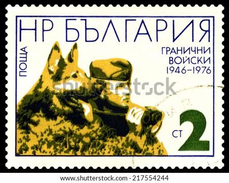 BULGARIA - CIRCA 1976: A Stamp printed in the Bulgaria  shows  Frontier Guard and German Shepherd, circa 1976  - stock photo