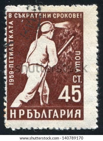 BULGARIA - CIRCA 1959: stamp printed by Bulgaria, shows Miner, circa 1959 - stock photo