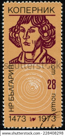 Bulgaria- CIRCA 1973:  stamp printed in Bulgaria, shows Nicolaus Copernicus, a Polish astronomer, mathematician, author of the heliocentric system of the world. Model of the solar system, circa 1973