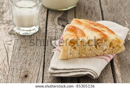 Bulgarian cheese pastry with cup of milk